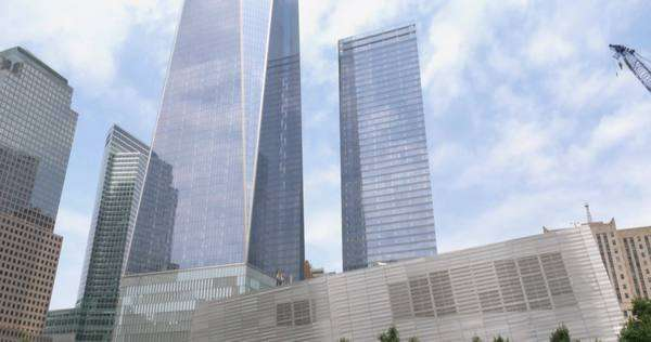 NEW YORK CITY - Circa July, 2014 - An establishing shot of the 9/11 memorial and Freedom Tower. Royalty-free stock video