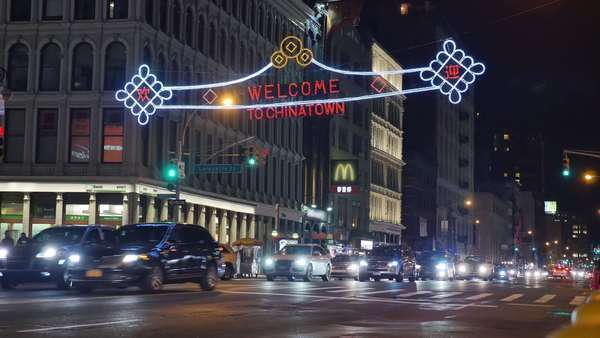 NEW YORK CITY - Circa December, 2014 - A nighttime establishing shot of an intersection in Chinatown in Manhattan. Royalty-free stock video