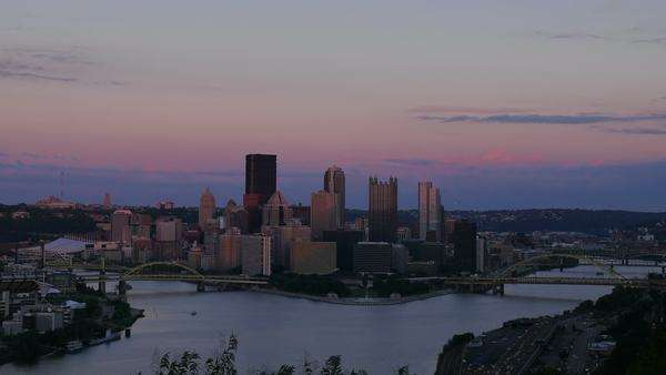 A day-to-night timelapse shot of the Pittsburgh city skyline as seen from the West End Overlook on a early Fall evening. Royalty-free stock video