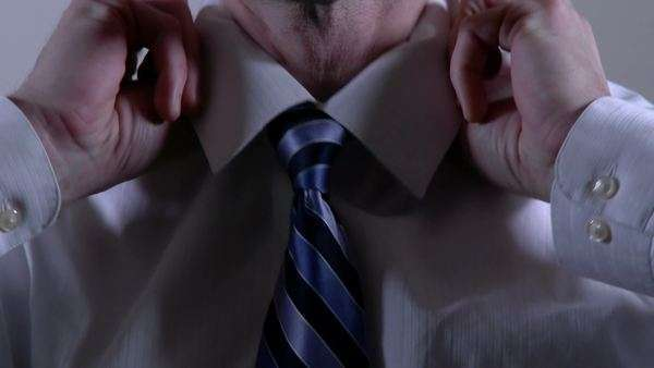 Closeup of a businessman tying a necktie. Royalty-free stock video