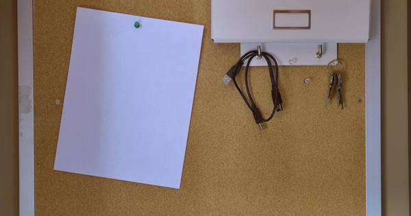 A worker places a blank piece of paper on a bulletin board. Royalty-free stock video