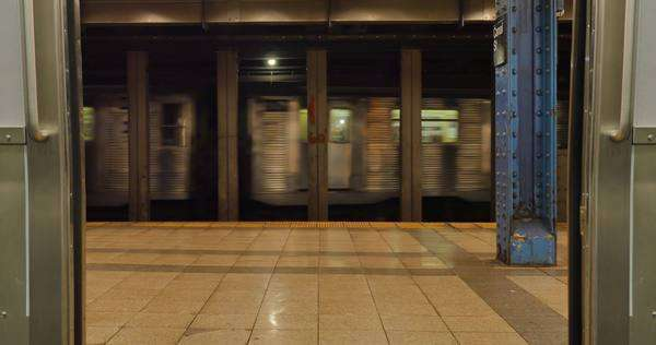 A low angle view of the doors of a New York subway car closing. Royalty-free stock video