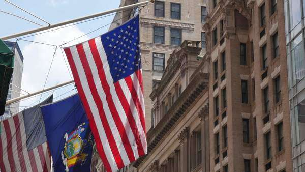 The American and New York State flags hanging outside of a Manhattan building. Royalty-free stock video