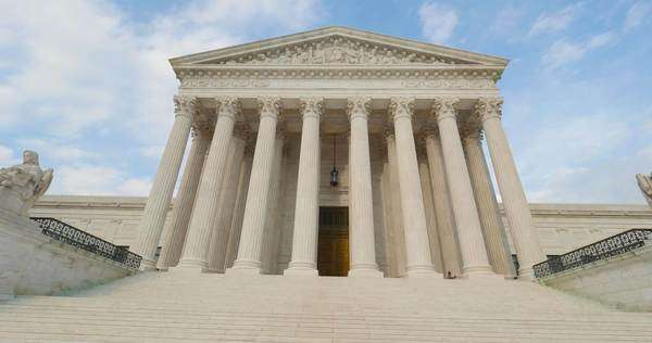 A tilt up view of the grand entrance of the Supreme Court. Royalty-free stock video