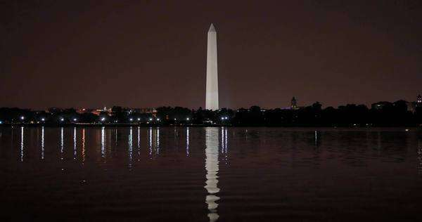A wide shot of the Washington Monument at night. Royalty-free stock video