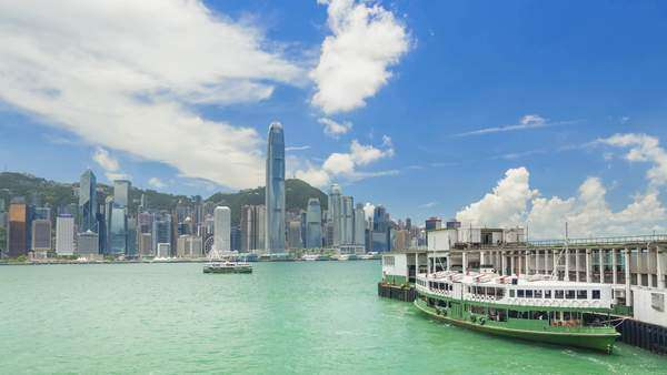 Timelapse of ferry terminal and Victoria Harbour in Hong Kong Royalty-free stock video