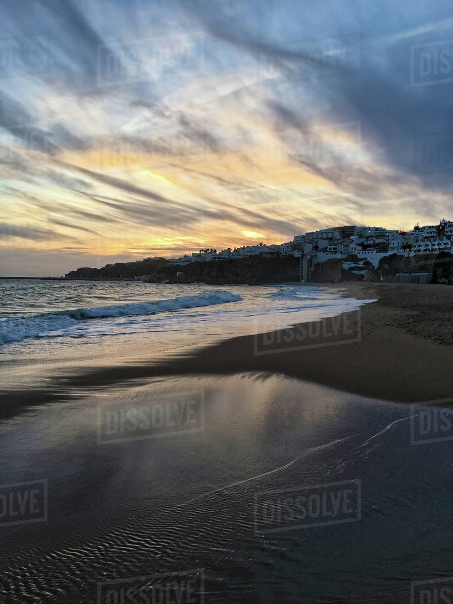 Vertical Of The Beach At Albufeira Portugal Sunset