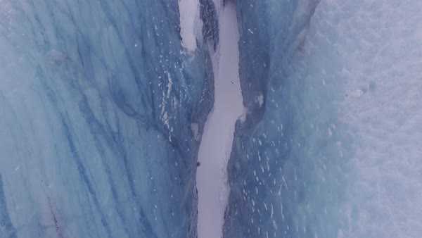 Aerial shot of glacier in Iceland, rising shot. Rights-managed stock video