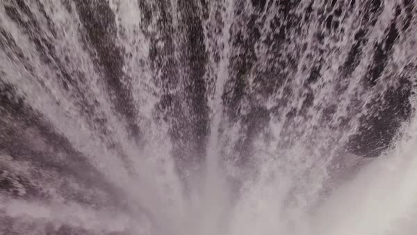 Aerial bird's eye view over Skógafoss waterfall in Iceland. Rights-managed stock video