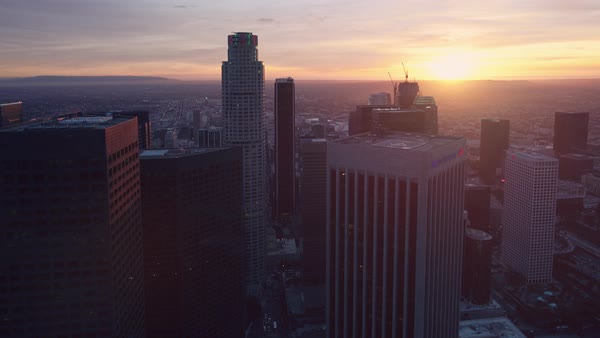 Los Angeles cityscape aerial pan at sunset. Rights-managed stock video