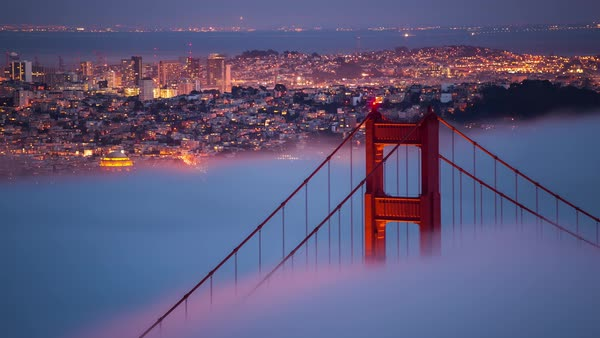 Long exposure, dreamy Golden Gate Bridge, fog San Francisco timelapse. Rights-managed stock video