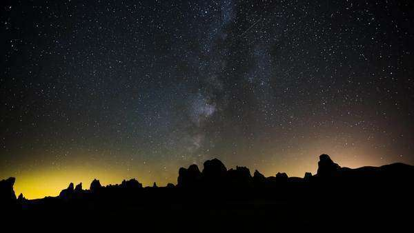 Timelapse tracking pan shot of Trona Pinnacles milky way tracking shot. Rights-managed stock video