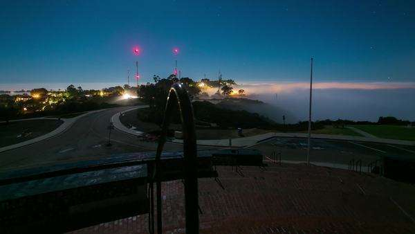Timelapse dolly shot of Mt Soledad fog at night, San Diego CA. Rights-managed stock video