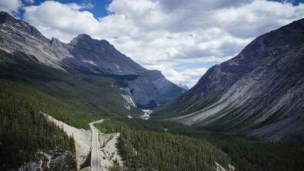 The road through Banff National Park and Jasper National Park, mountain timelapse. Rights-managed stock video