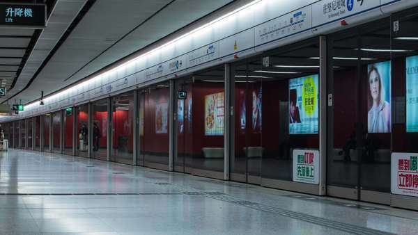 Timelapse static shot of busy Hong Kong subway station. Rights-managed stock video