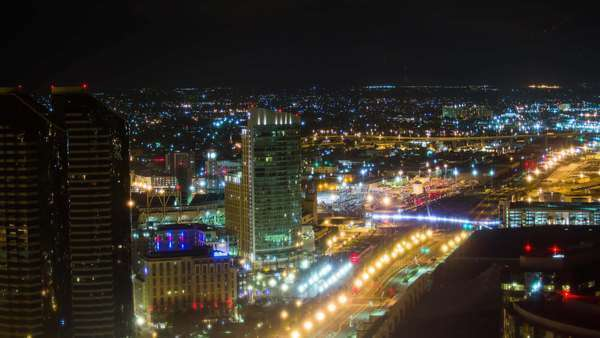 Timelapse static shot of San Diego Downtown cityscape view at night. Rights-managed stock video
