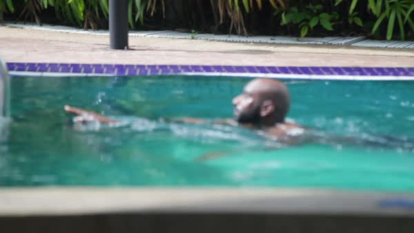 Slow motion shot of a man swimming in a pool Royalty-free stock video