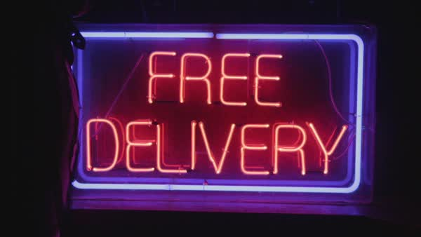 Hand-held shot of a free delivery neon sign Royalty-free stock video