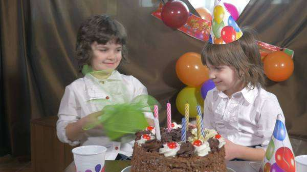 Young Beautiful Girl Receiving A Present At Birthday Party Royalty Free Stock Video