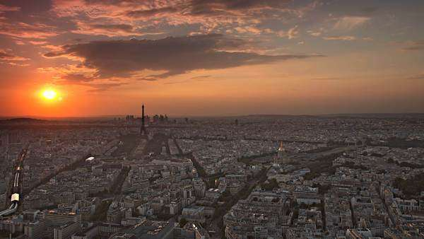 Paris skyline aerial day to night timelapse at the sunset to night city lighting up sparking Eiffel Tower panorama from Montparnasse Royalty-free stock video