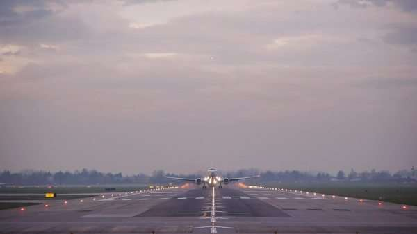 Airplane taking off passing over head at Bologna airport, tracking shot Royalty-free stock video