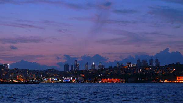 Istanbul, Turkey: City skyline of the financial center at night, as seen from the Bosphorus Sea Royalty-free stock video