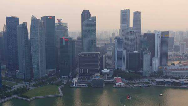 Singapore,singapore,15/08/2015:singapore skyline business center district seen from aerial view pan shot across the bay Royalty-free stock video