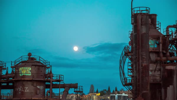 Timelapse shot of the full moon rising above an industrial plant Royalty-free stock video