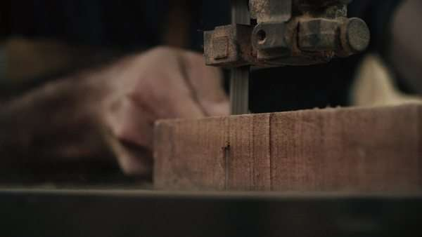 Handheld extreme close-up of a carpenter cutting wood Royalty-free stock video