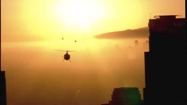 Handheld shot of helicopters flying over a city Royalty-free stock video