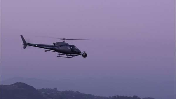 Wide shot of a helicopter flying in the sky Royalty-free stock video