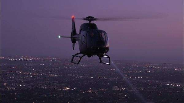 Handheld shot of a flying helicopters at night Royalty-free stock video