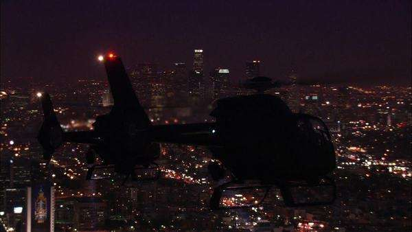 Handheld wide shot of helicopters flying at night Royalty-free stock video