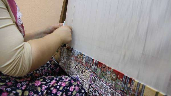 Carpet weaving. Turk woman, carpet-makers at weaving factory in Turkey Royalty-free stock video