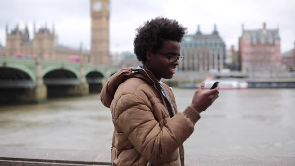 Medium shot of a young man using his smartphone Royalty-free stock video