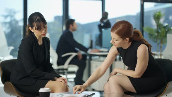 Businesswomen in a meeting with colleagues working in background Royalty-free stock video