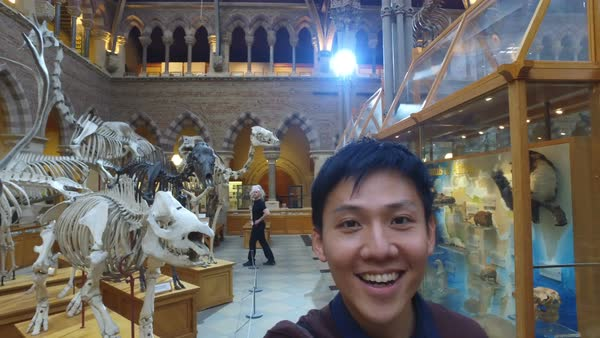 Young Asian man in museum video recording himself and the exhibits Royalty-free stock video
