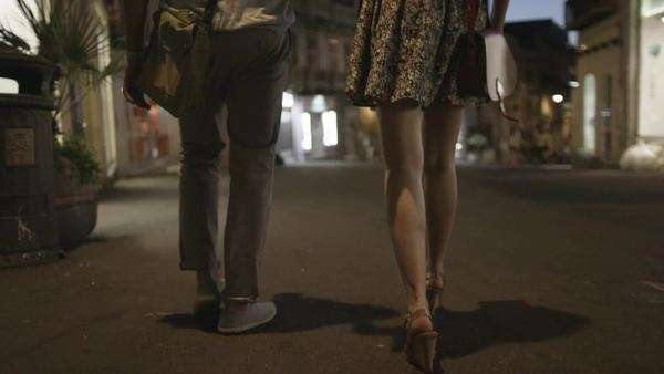 Attractive couple walking together, exploring the city at night Royalty-free stock video