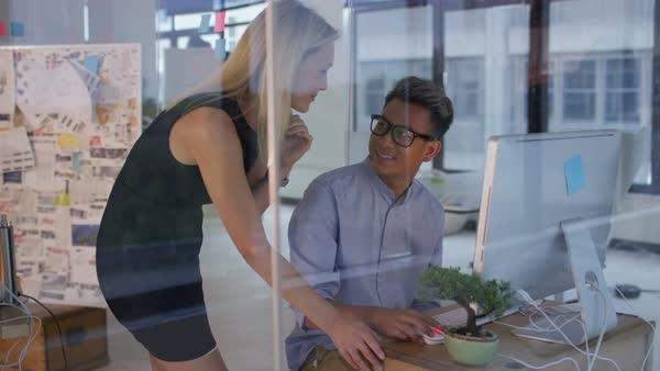Business man and woman collaborating on a project in creative office. Royalty-free stock video