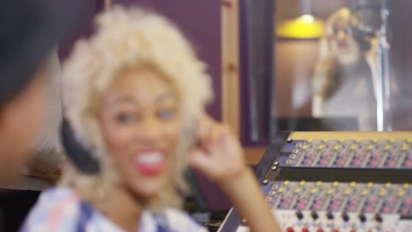 Professional team in recording studio mixing a track with female vocalist. Royalty-free stock video