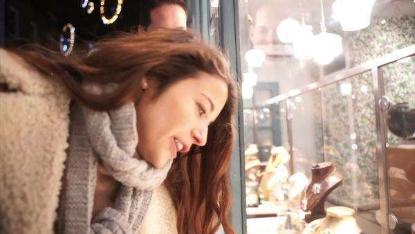 Attractive romantic couple shopping in the city at Christmas time. Royalty-free stock video