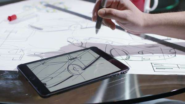 Hands using computer tablet with creative automotive design drawings Royalty-free stock video