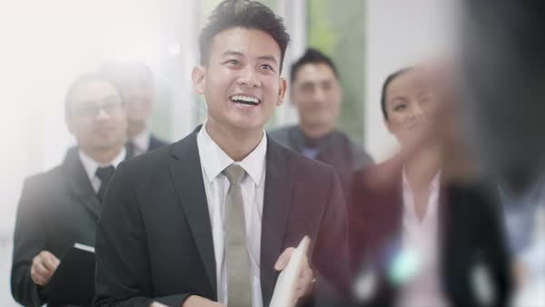 Cheerful Asian business group clapping the speaker at business conference. Royalty-free stock video