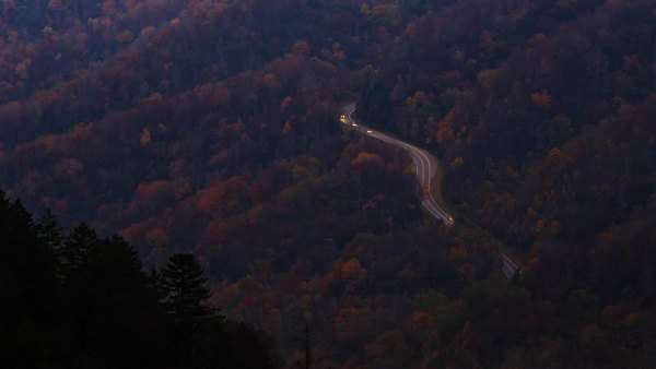 Cars drive on a curvy road in The Great Smoky Mountains, timelapse Royalty-free stock video