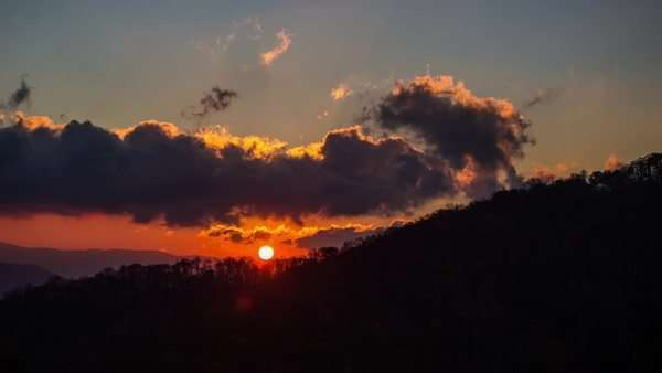 Sunrise as the sun passes through some large clouds in The Great Smoky Mountains, timelapse Royalty-free stock video