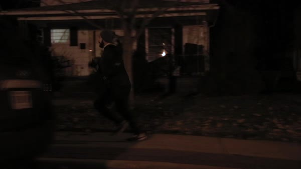 Tracking shot of a man running on a sidewalk in the early morning Royalty-free stock video