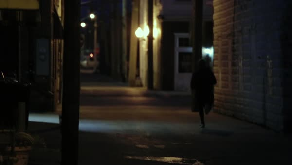 Hand-held shot of a man running on a street in the early morning Royalty-free stock video