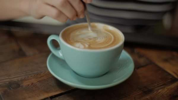 Close-up shot of a woman eating the foam of the cappuccino Royalty-free stock video