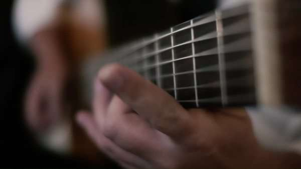 Guitar player playing acoustic Spanish guitar with the utmost dexterity across the fretboard Royalty-free stock video