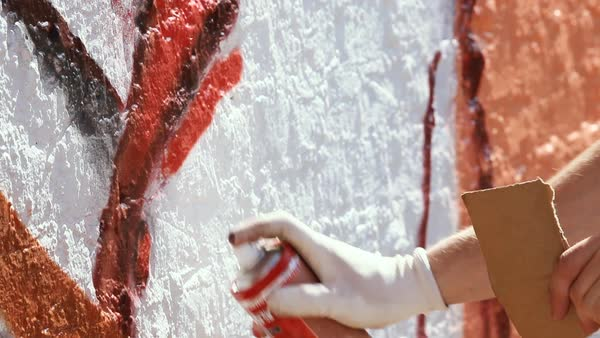 Close-up shot of a person painting a graffiti Royalty-free stock video